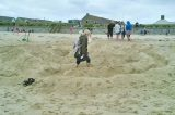 Methodist Group Running Maze Event On Beach