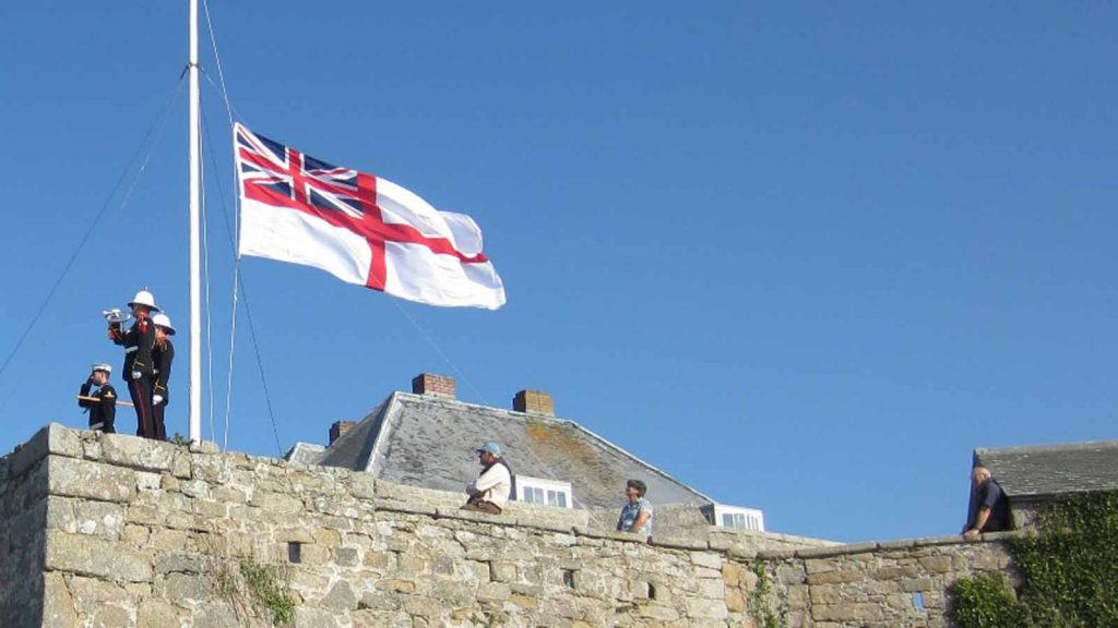 The White Ensign is lowered. Photo by Robin Mawer.