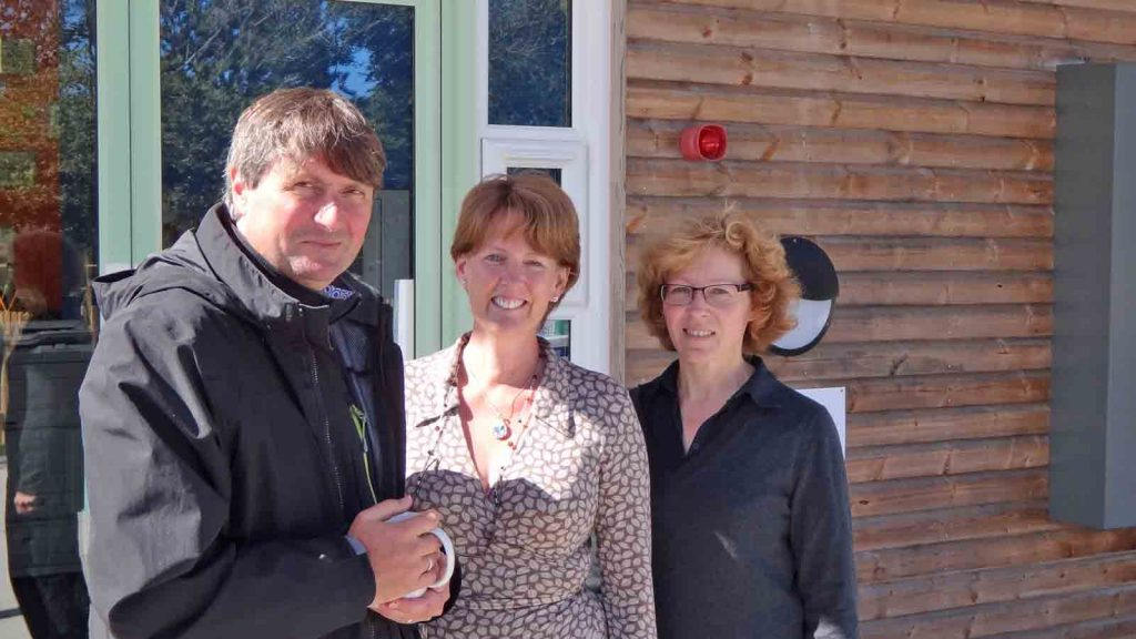 Simon Armitage with head teacher Linda Todd and English teacher Bev Knox