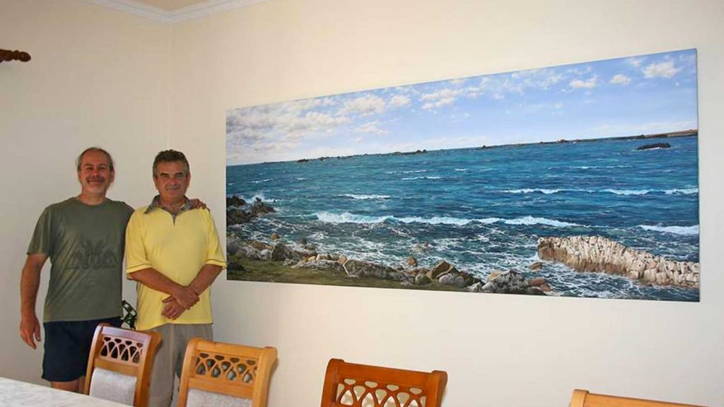David Smith (right) with his painting of St Agnes by Vernon Jones (left)