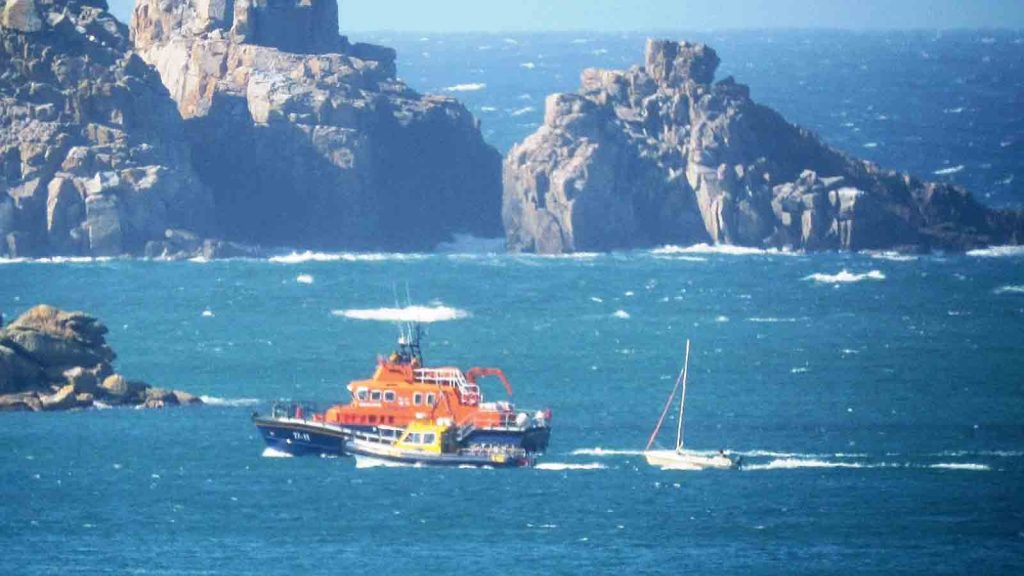 The Cyclone towing the dinghy, accompanied by the lifeboat. Photo by Robin Mawer.