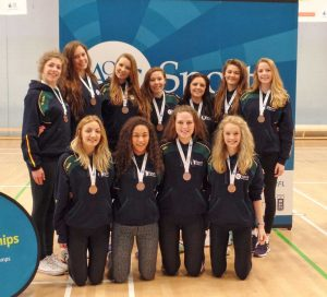 The Girls' Netball team with their bronze medals.