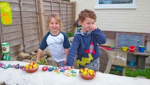 Martha and Noah help to create some painted limpet shells