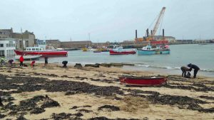Volunteers help clean up Town Beach on St Mary's