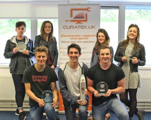 The Curatek team receiving their award.