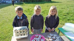 School children made 'pup' cakes to raise money for a guide dog.