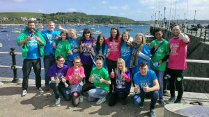 The group of volunteers on Prince of Wales Pier, Falmouth. Image with thanks to Fixers.