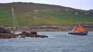 The lifeboat aiding the grounded yacht. Photo by Roger Boughton.