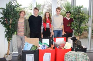Billy Rickards, Callum Bird, Grace Harding, Peter Rowe and Gawen Osborne from the Truro College Student Council with items donated to the refugee appeal.