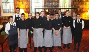 The Front of House team from Truro College (centre) with team members from Headland Hotel.