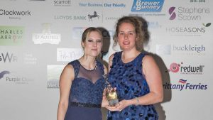 Hell Bay hotel head receptionist, Francecsa McNeill (right) collects the Gold Award.